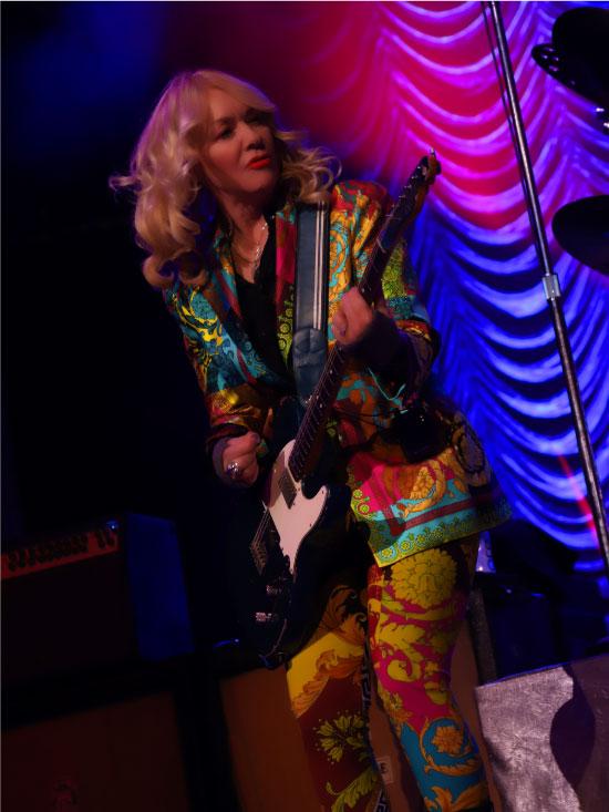 Nancy Wilson playing guitar